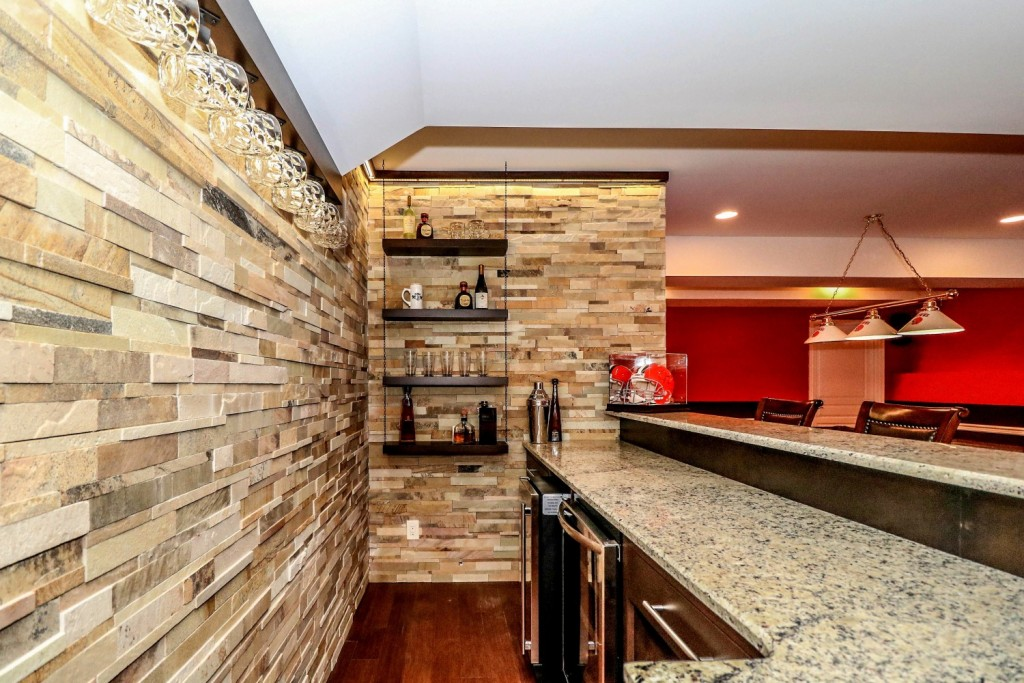 Stone wall and floating shelves | Monroe, NJ | Distinctive Interior Designs