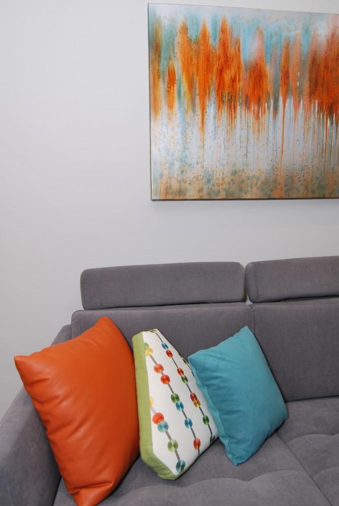 Contemporary city condo grey orange teal accessories