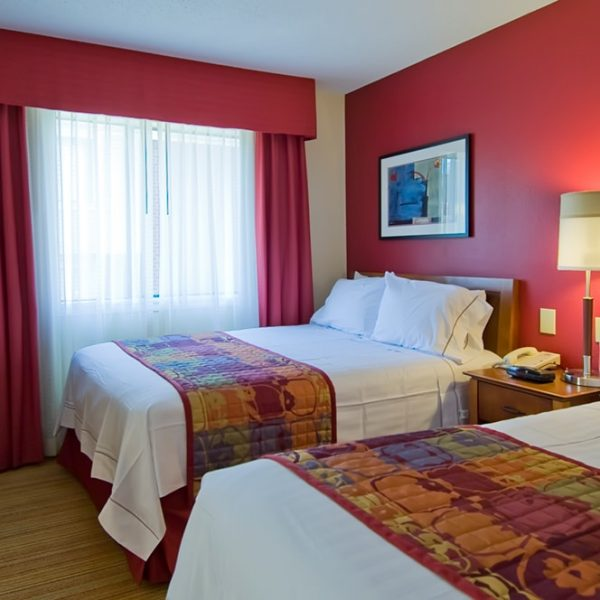 Hotel room design project by commercial interior design firm Distinctive Interior Designs in New Jersey & Philadelphia