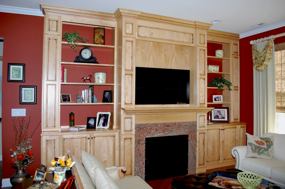 Custom built media center and fireplace by NJ interior design firm Distinctive Interior Designs