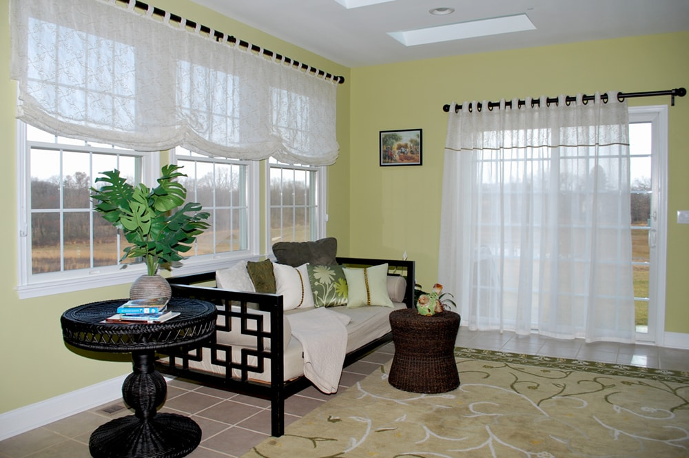 Living room with custom window treatments by top NJ PA interior design firm Distinctive Interior Designs
