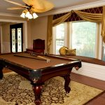 Pool table room with window seat and custom window treatments by NJ interior design firm Distinctive Interior Designs
