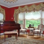 Living room with Piano and custom window treatments by Philadelphia and NJ interior designer Distinctive Interior Designs