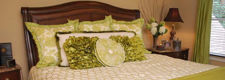 Master bedroom decorative bed pillows by NJ interior design firm Distinctive Interior Designs