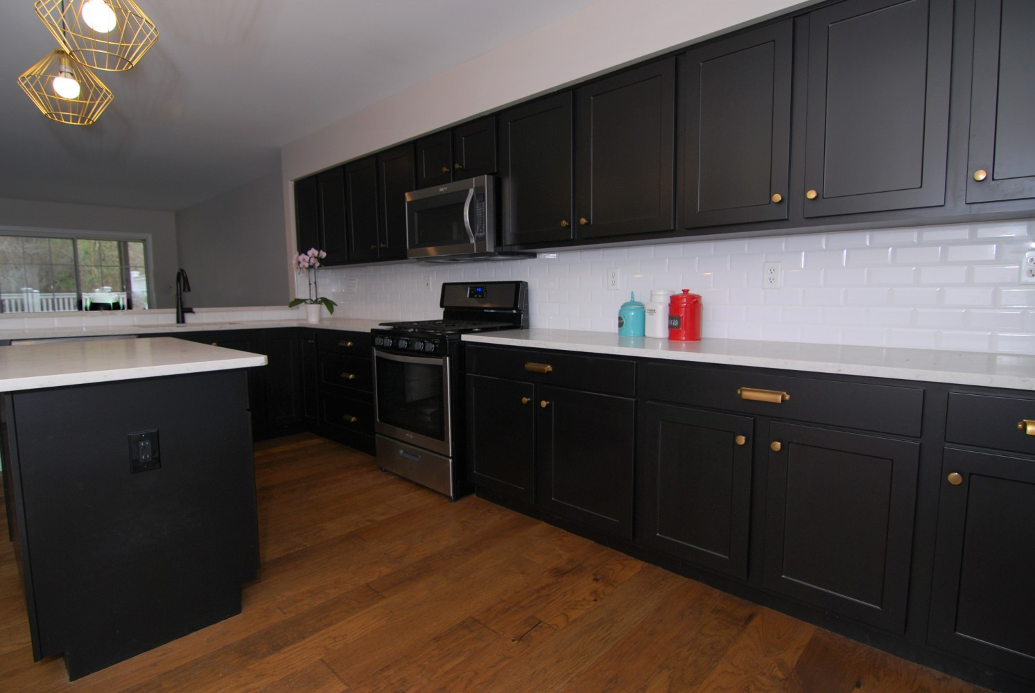 Reface kitchen black cabinets satin gold knobs | Pennington NJ | Distinctive Interior Designs