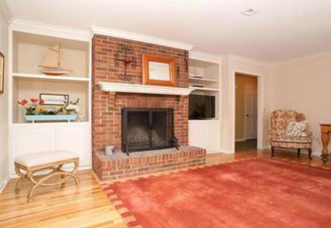 Family room fireplace before photo NJ interior designer Distinctive Interior Designs