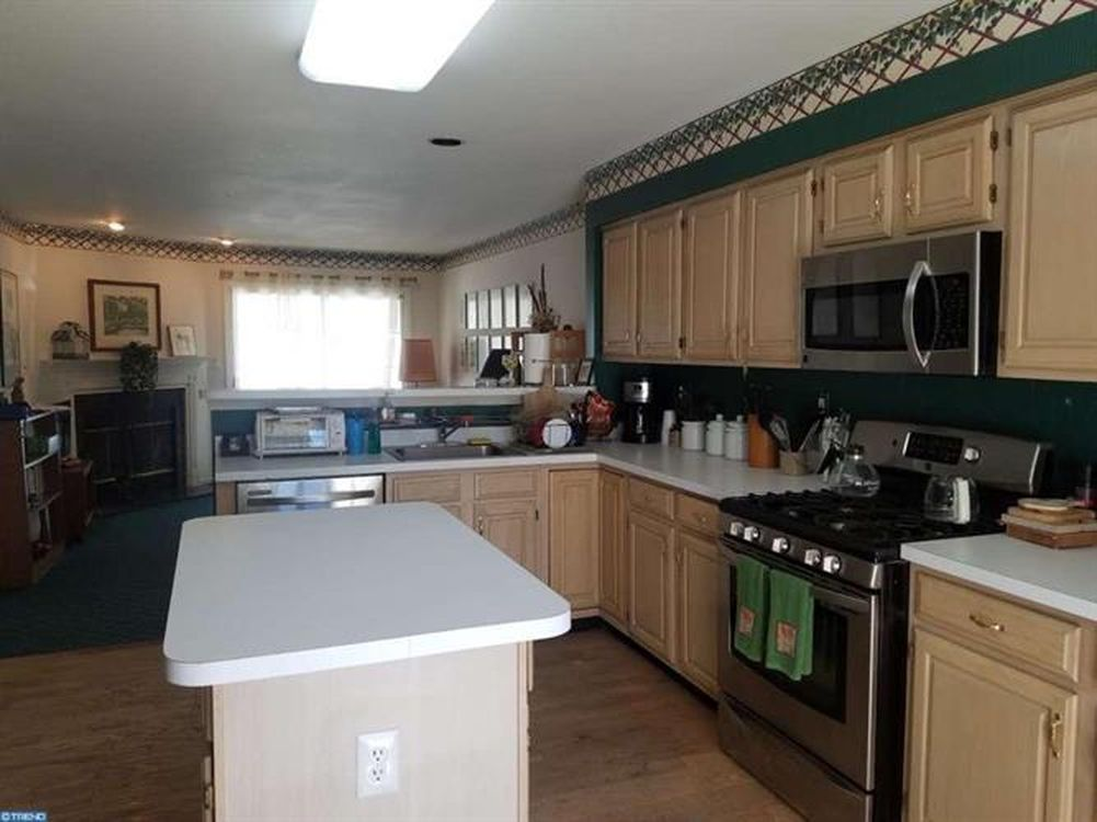Kitchen before picture by NJ PA interior design firm Distinctive Interior Designs