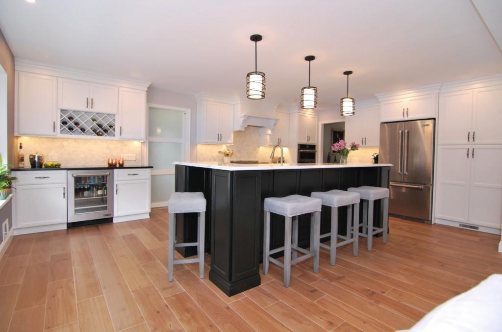Black island white cabinet kitchen