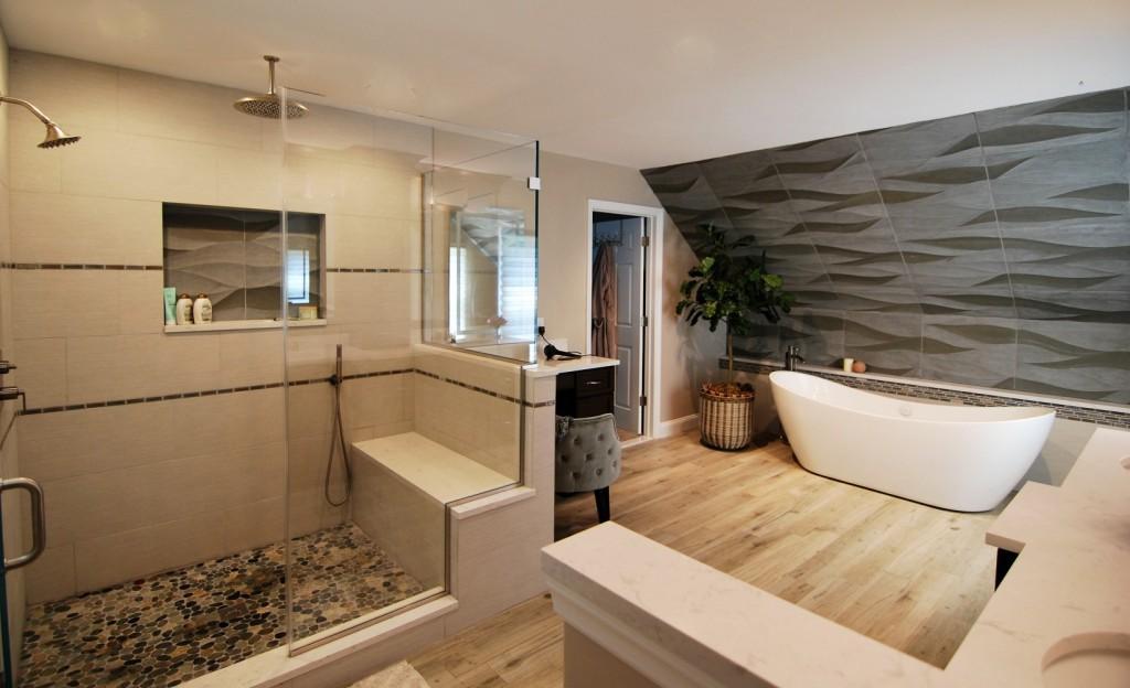 Wood tile wave tile custom shower with bench freestanding tub