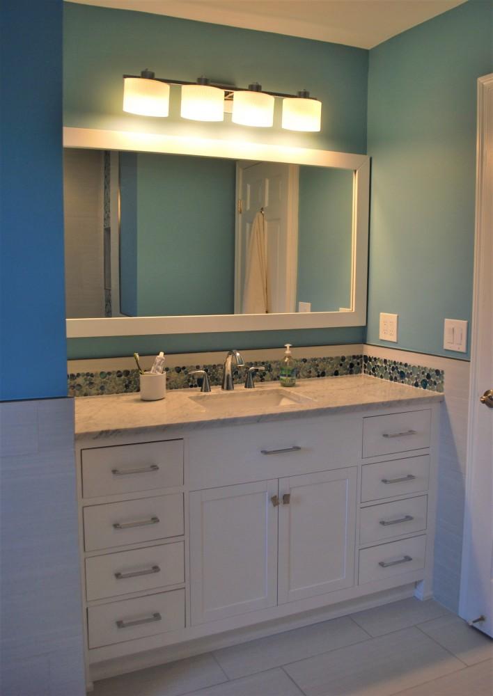 White cabinet carrara blue bubble tile