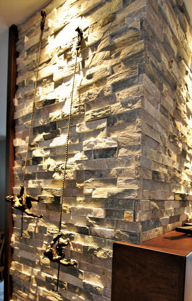 Stacked stone climbing men art| Cherry Hill NJ | Distinctive Interior Designs