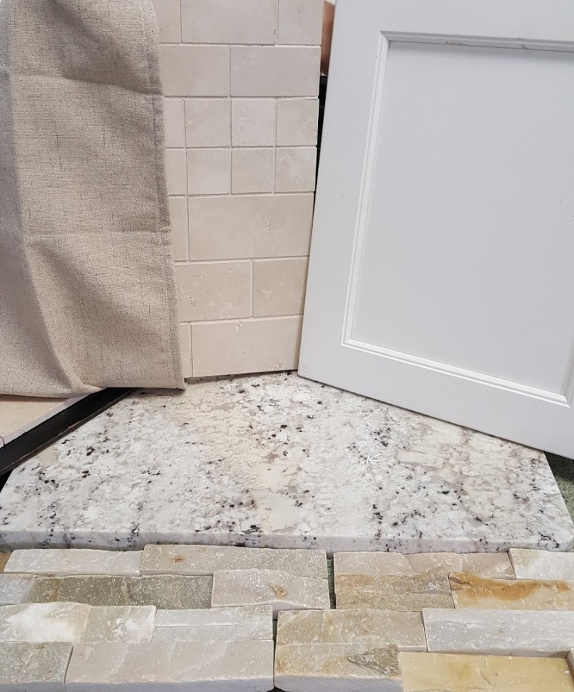 Combo of stacked stone, fantastic white granite, backsplash tile