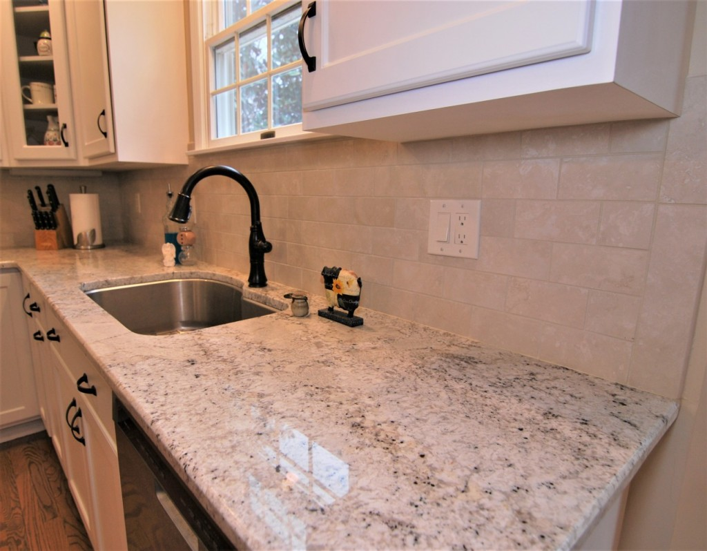 Fantastic white counters oil rubbed bronze accents subway tile backsplash