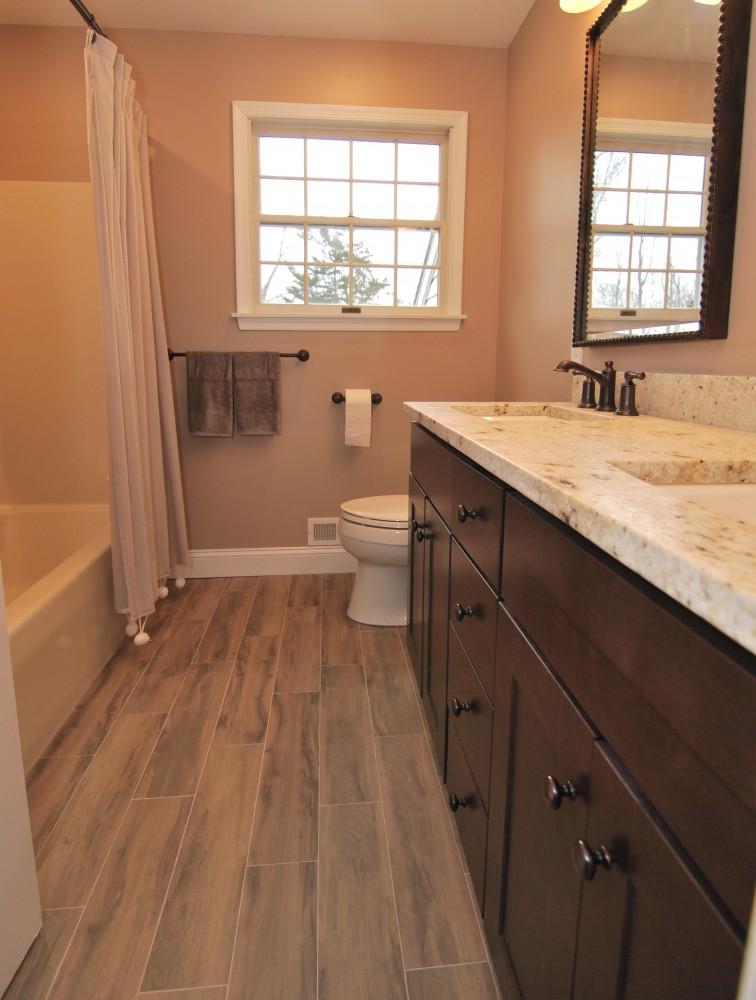 Hall bath dark wood vanity Botanica Cashew floor tile bisque tub