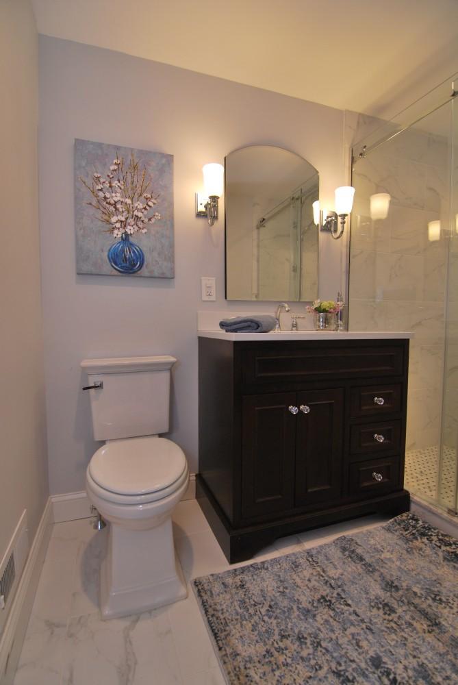 Carrara Bathroom with new toilet and custom vanity