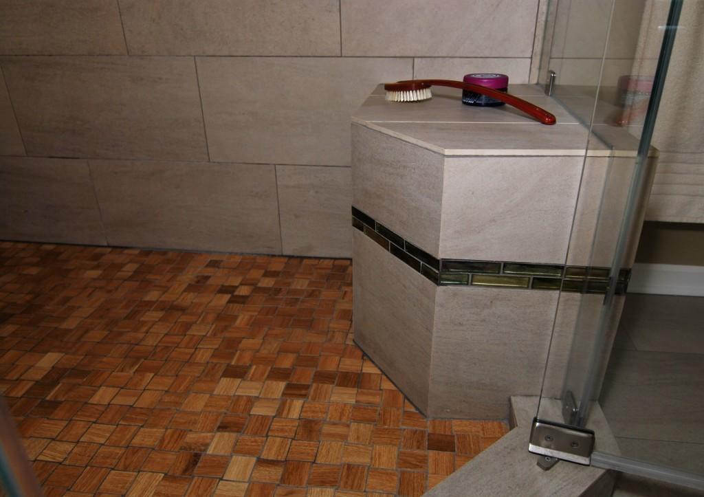 Custom shower with cedar look basket weave floor and inset bench