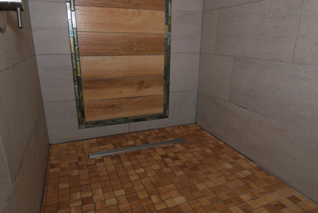 Cedar plan tile with irredescent olive glass tile accents in custom shower