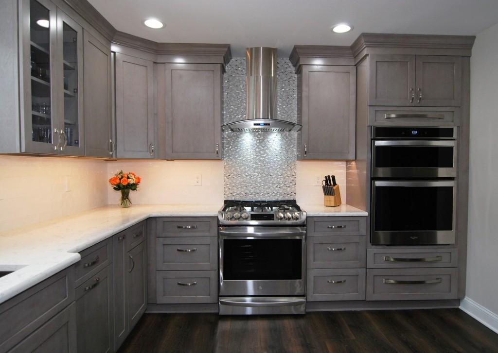Galaxy Horizon Fabuwood hood and range with silver mosaic backsplash, wall microwave and oven