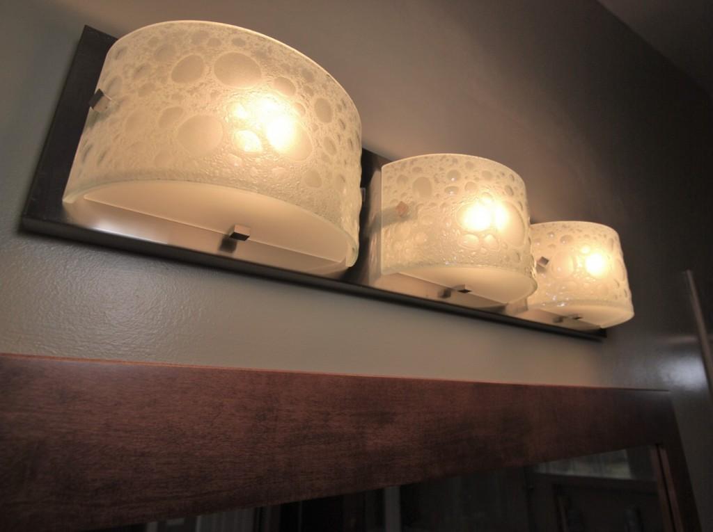 Bubble glass and chrome triple bulb vanity light