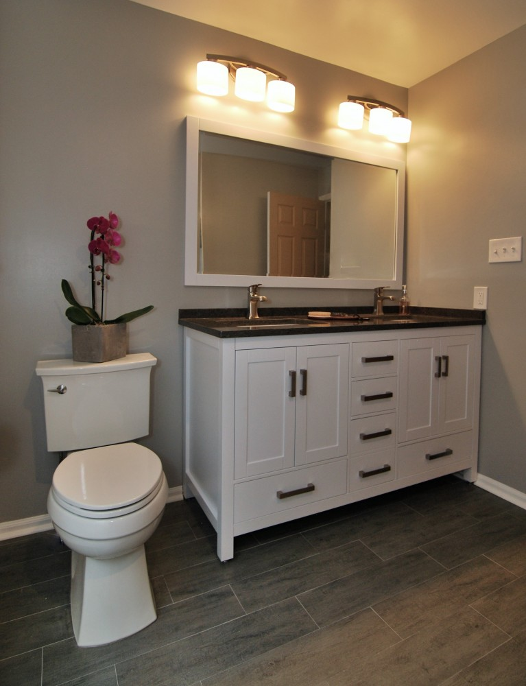 Grey and white second bath with wood look 6x30 floor tile
