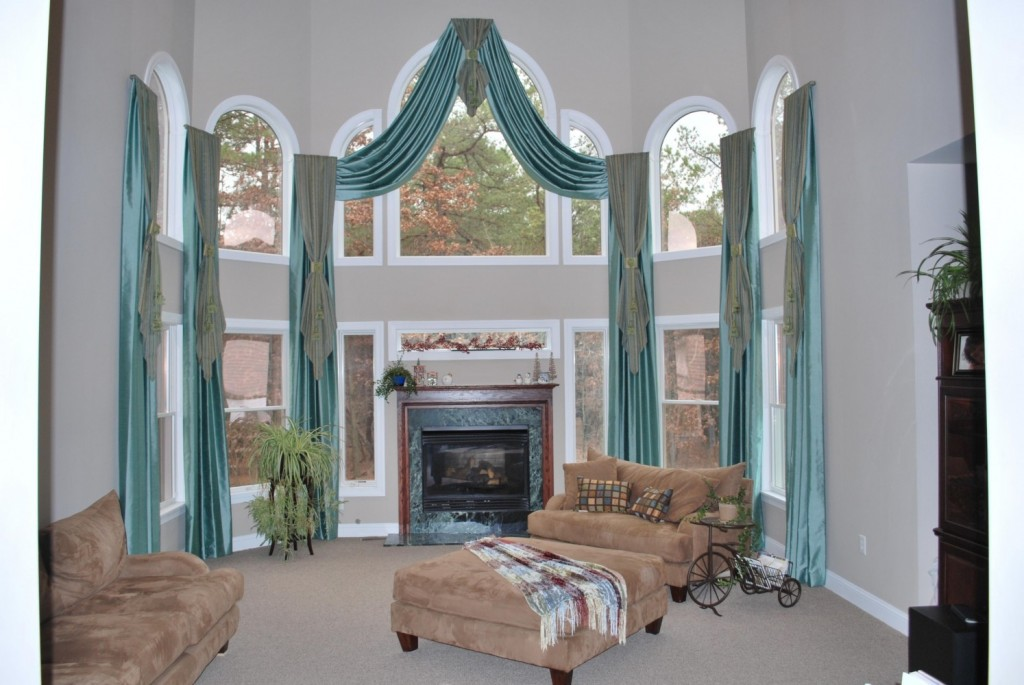 Flipped top double story draperies on arched topped windows