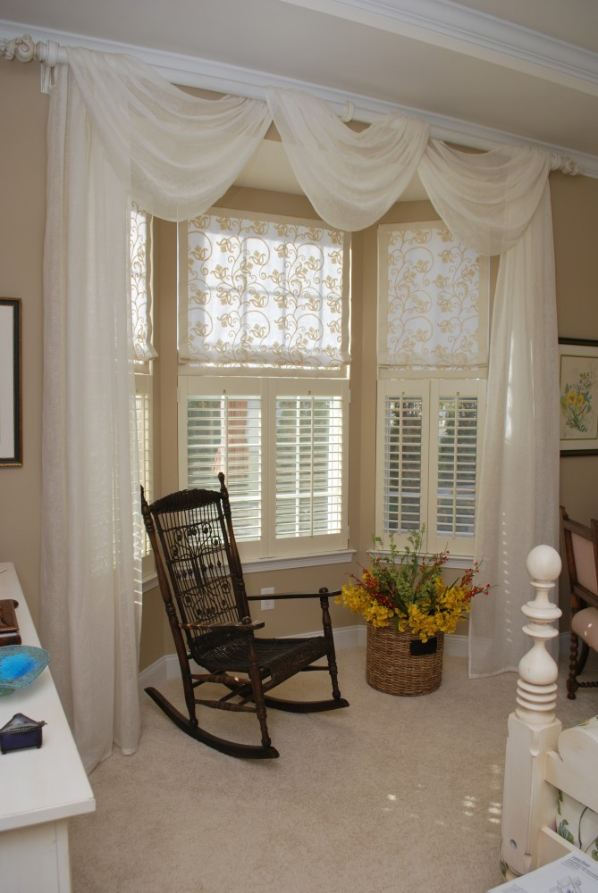 Sheer swags and panels with Roman shades & cafe shutters