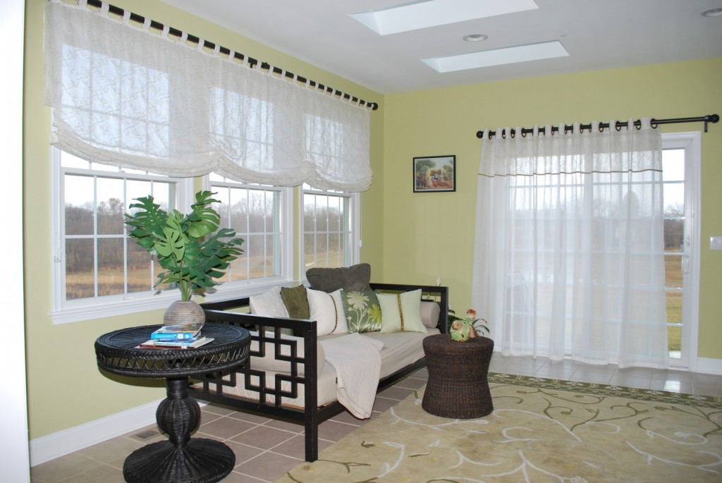 Green room with White Sheer Relaxed Roman and Grommet drapes