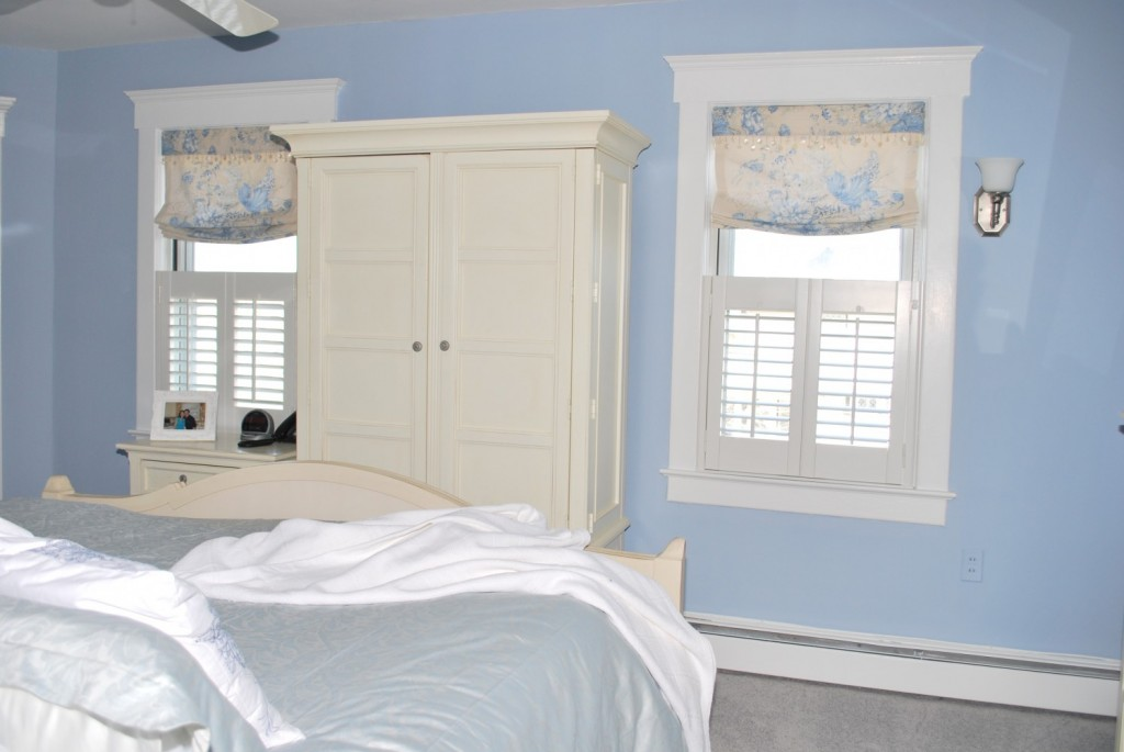 Relaxed Roman shades with cafe Shutters