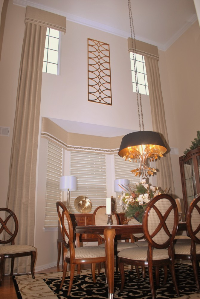Double Story Pleated drapes with cornices and Uttermost metal wall accent piece