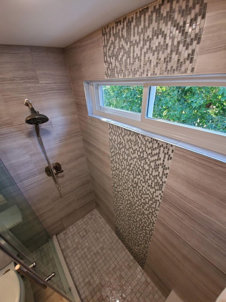 Custom shower vertical accent with narrow wide window