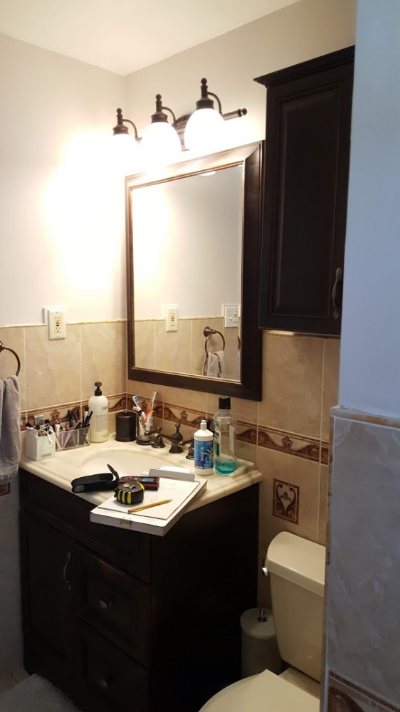 Vanity and mirror in small master bath before reno