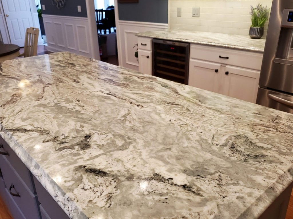 Brown Fantasty Granite in gray and white kitchen