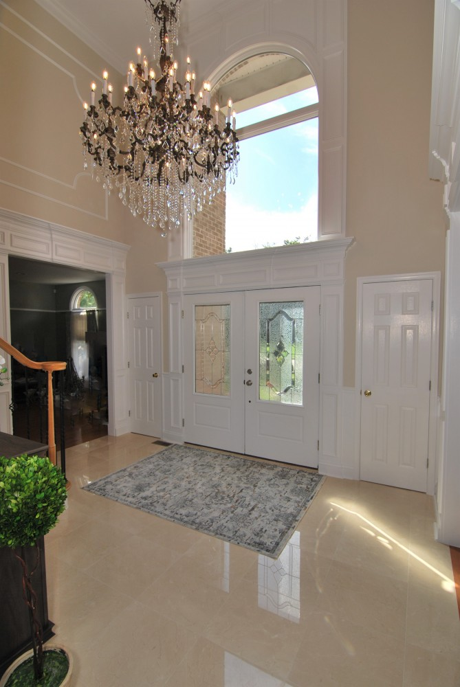Crema Marfil tile floors custom wood work arched window