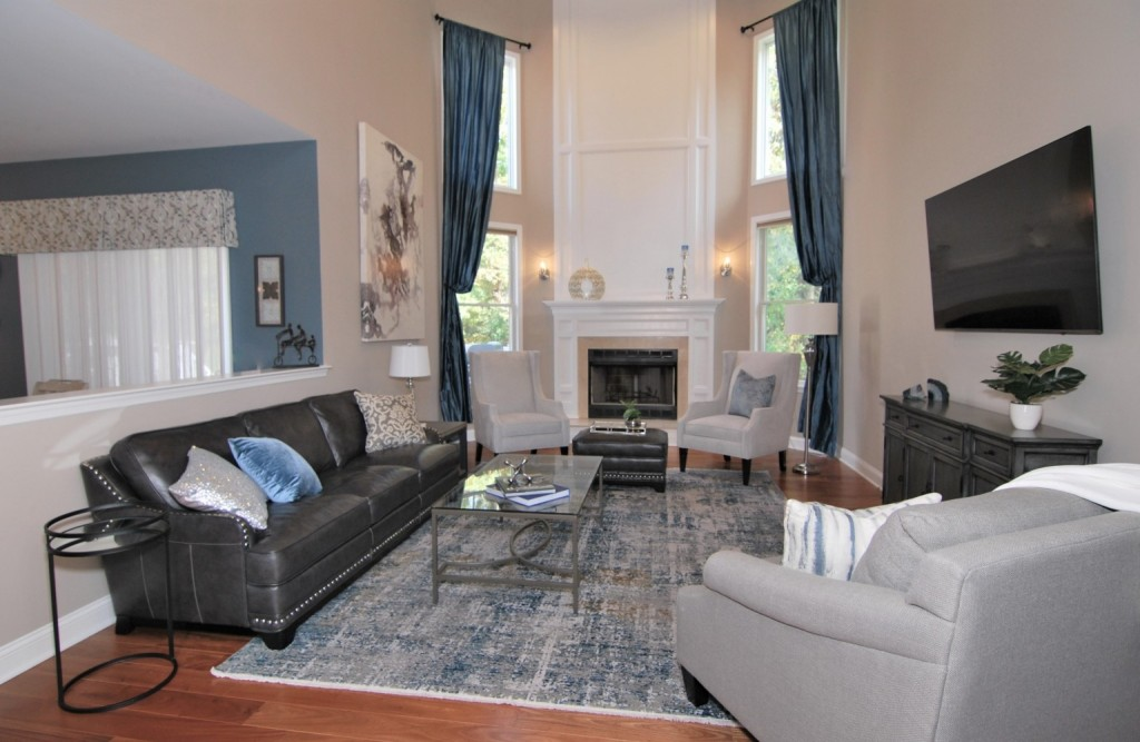 Double story grey leather couch with slate blue