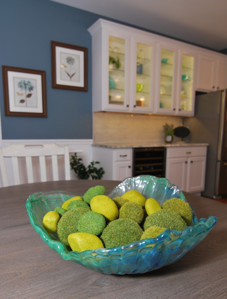Glass cabinet door with Great blue and green accessories