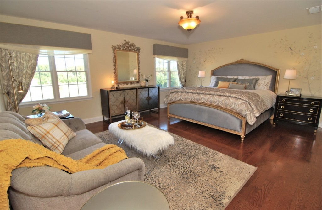 Gold and gray eclectic master bedroom suite