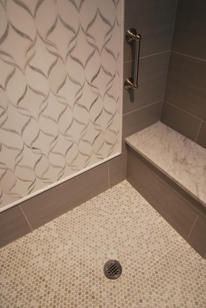 Gray white penny tile carrara custom shower