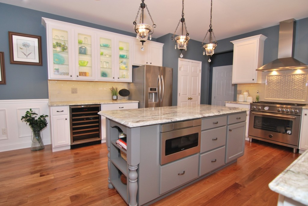 Microwave in island with refaced cabinets white gray
