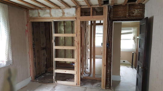 Breaking out back of 1920s closet to create a master bath