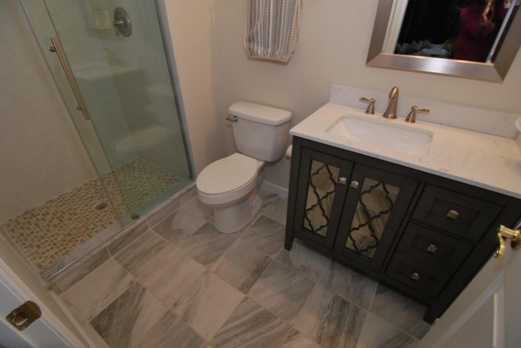 Grey single vanity and marble porcelain floors