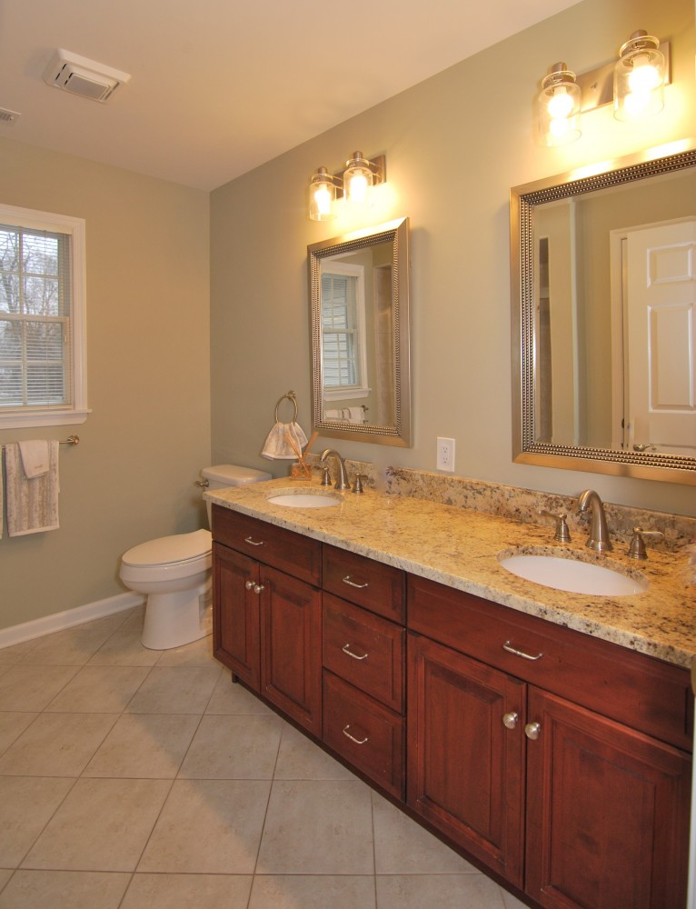 Hall bath double vanity with new granite lights and mirrors
