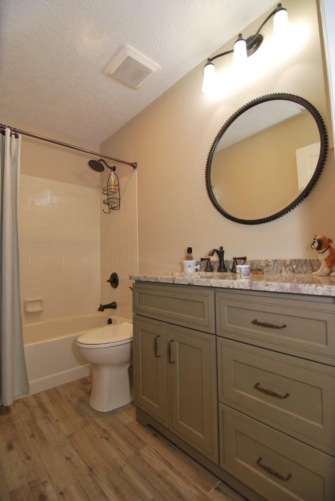 Hall bath green vanity typhoon bordeaux oil rubbed bronze fixtures