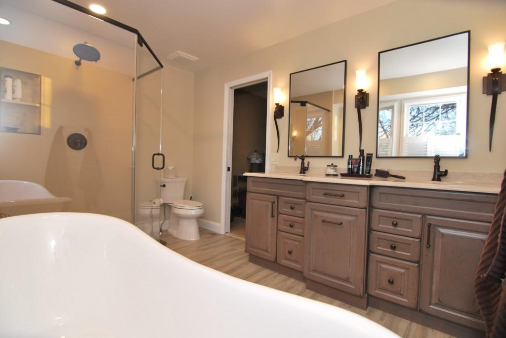 Master Bath claw foot tub grey distressed double vanity pocket door