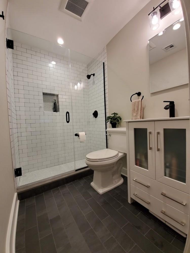 slate tile, white subway tile, penny tile, black grout, black fixtures