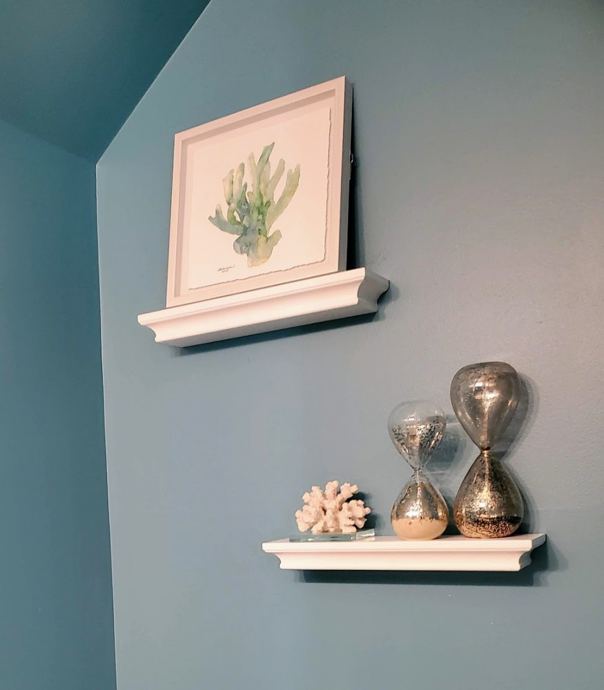 Beach house powder room with floating shelves and accessories