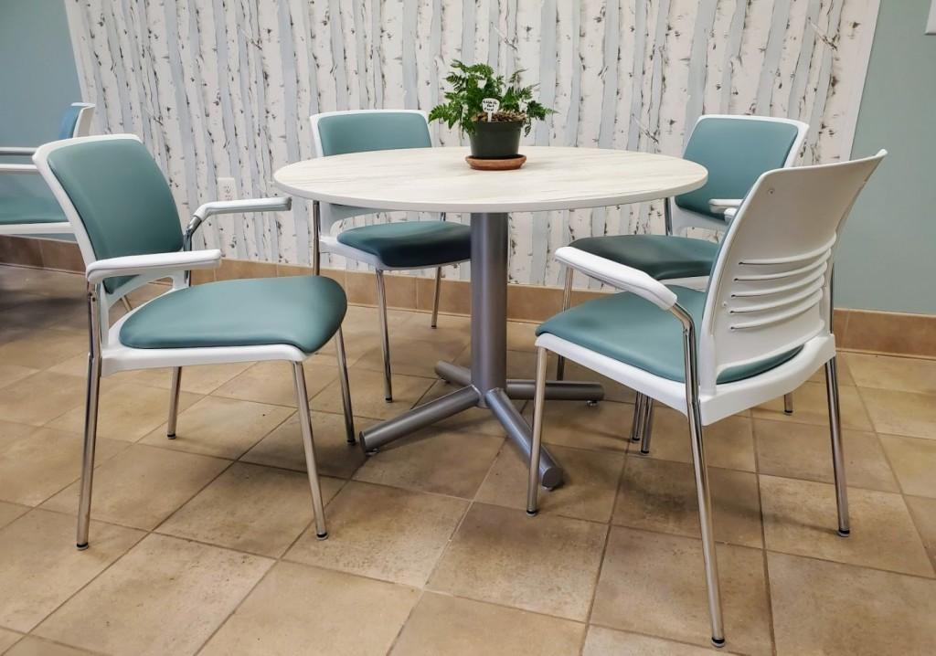 Makai Dekton table top with Grazie Stack chairs birch wallpaper