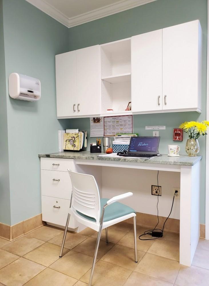 New desk area in solarium, refaced slab door cabinets