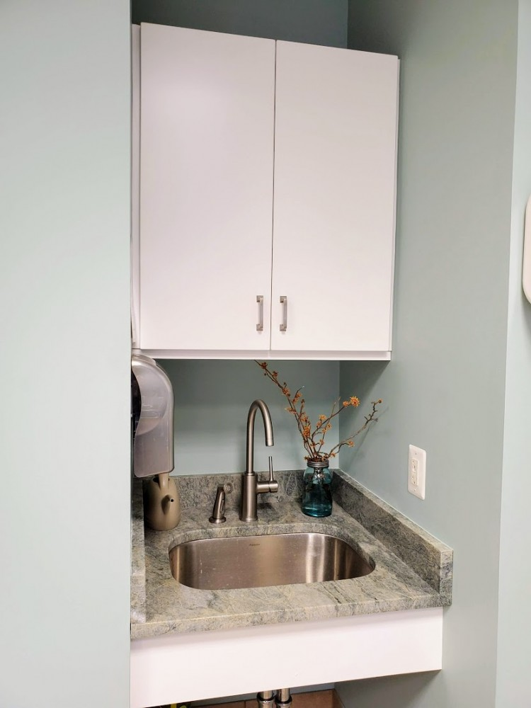 New sink area with Costa Esmeralda leathered counters