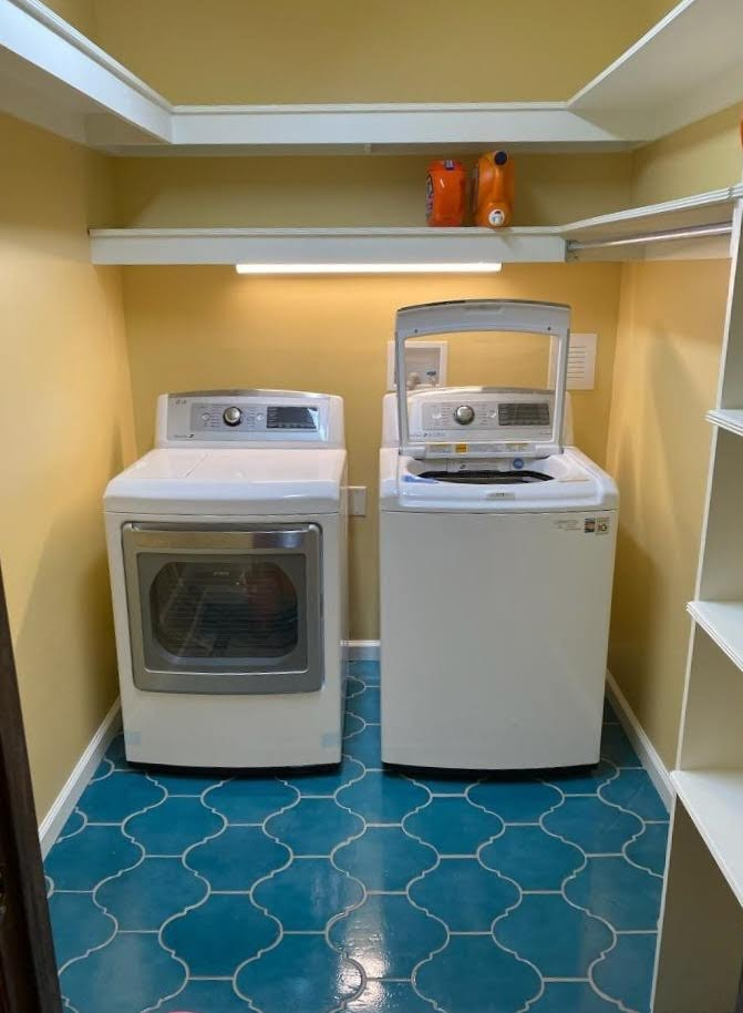 Closet converted to Laundry room after new tile and paint