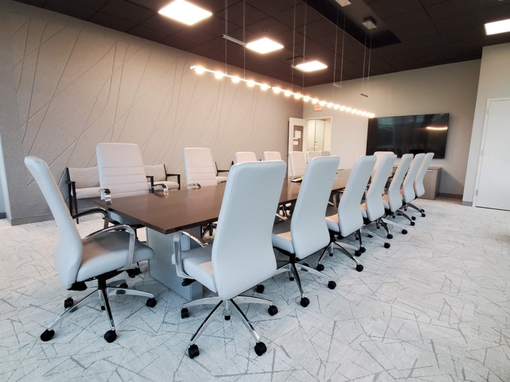 Scribe acoustic panel with Board Room table and chairs